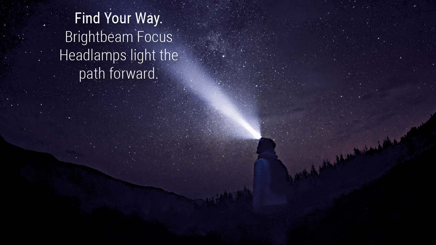 Find Your Way. Brightbeam focus headlamps light the path forward. Woman with headlamp looking at the night sky