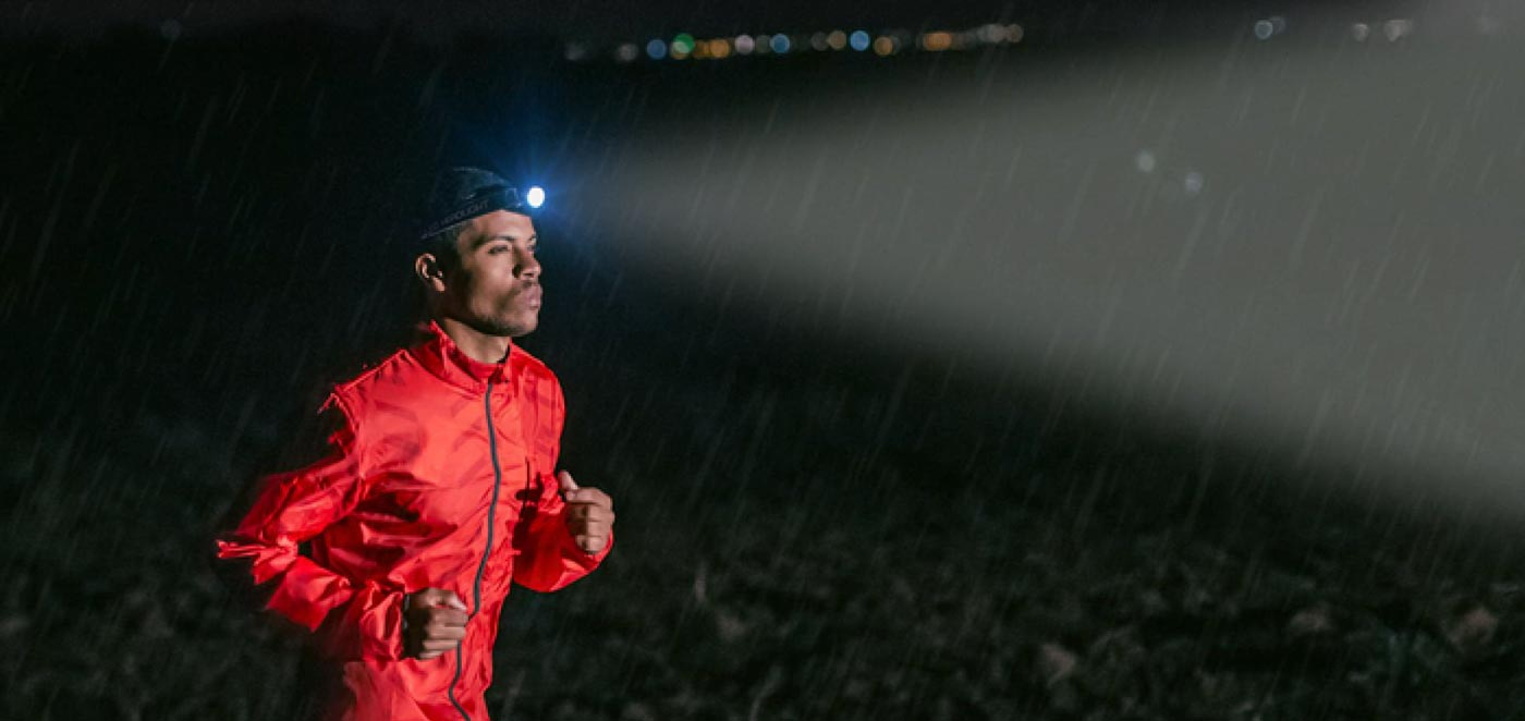 Guy running with Everbrite Headlamp at night